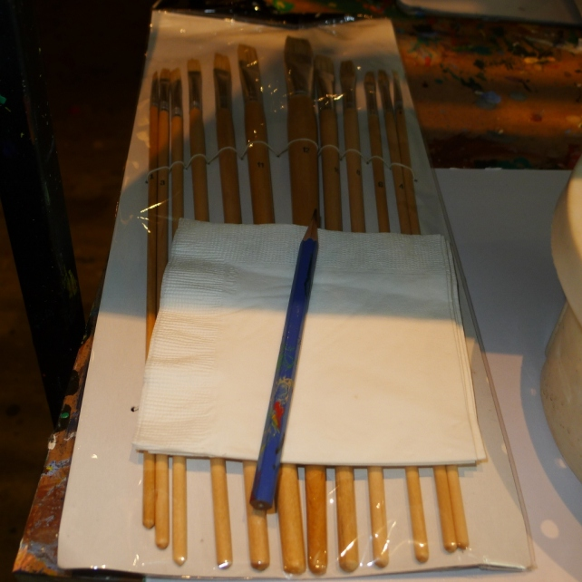 Pencil for sketching and napkins for drying wet brushes.